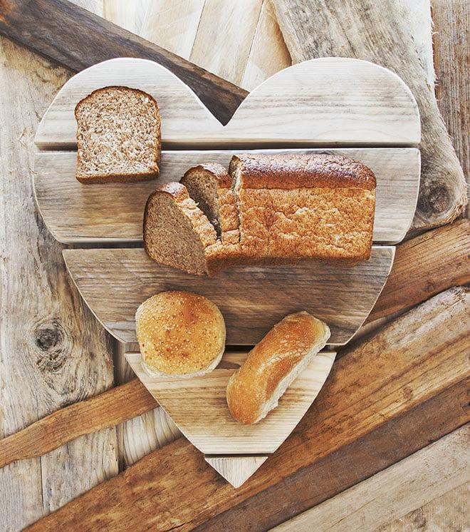 Breads on rustic vintage heart background loving healthy food-AdobeStock_259803965